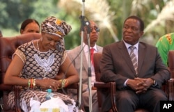FILE - Zimbabwean first lady Grace Mugabe (L) sits next to vice President Emmerson Mnangagwa at the Zanu pf headquarters in Harare, Feb, 10, 2016.