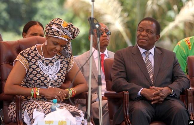 FILE - Zimbabwean then-first lady Grace Mugabe (L) sits next to Emmerson Mnangagwa at the ZANU-PF headquarters in Harare, Feb, 10, 2016.