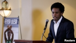 FILE - Rio Olympic marathon silver medalist Feyisa Lilesa of Ethiopia attends a news conference in Washington, Sept. 13, 2016.