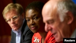 U.N. humanitarian chief Valerie Amos, center, and World Health Organization (WHO) Assistant Director General Bruce Aylward, left, listen to Dr. David Nabarro, senior U.N. coordinator for Ebola, speak during a news conference on Ebola at the United Nations