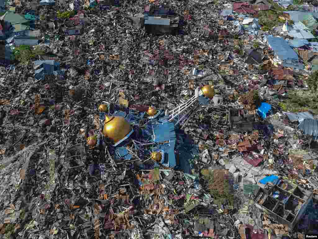 An aerial view of an area devastated by an earthquake in Palu, Central Sulawesi, Indonesia, in this photo taken by Antara Foto.