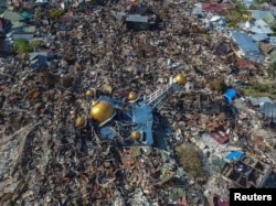 An aerial view of an area devastated by an earthquake in Palu, Central Sulawesi, Indonesia October 1, 2018 in this photo taken by Antara Foto.