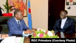Freddy Matungulu (G), mokambi ya BAD (Banque africaine de développement) na masolo Ministre wa yambo Sylvestre Ilunga Ilunkamba na Kinshasa, RDC, 4 novembre 2019. (Primature RDC)