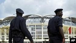 Angolan policemen patrol outside of Chiazi stadium in Cabinda, 11 Jan 2010
