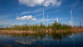 FILE - An Ares test rocket sits on a launch pad at the Kennedy Space Center in Cape Canaveral, Florida.