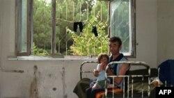 Грузинские беженцы, живущие в здании бывшего военного госпиталя в Тбилиси. Снимок сделан 20 августа 2008 года
