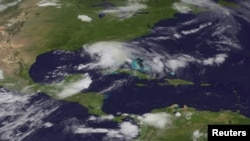 Tropical Storm Debby is pictured in the Gulf of Mexico this June 24, 2012