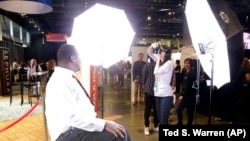 FILE - Dwight Walton, of Seattle, has a photo taken for his LinkdIn social networking profile at a job fair in Seattle sponsored by the 100,000 Opportunities Initiative. (AP Photo/Ted S. Warren)