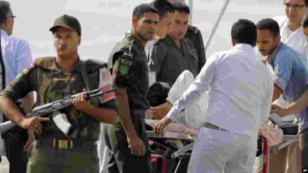 Former Egyptian President Hosni Mubarak, 85, is escorted by medical personnel, Cairo, Egypt, Sunday, Aug. 25, 2013.