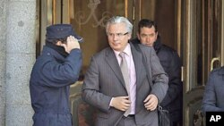 Baltazar Garzon, once widely regarded as Spain's most prominent magistrate, leaves the Supreme Court in Madrid, January 17, 2012.