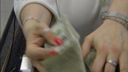 Kontroversi Uang Kertas dan Uang Logam Satu Dolar - Laporan VOA 27 Oktober 2011