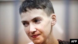 FILE - Ukrainian military officer Nadezhda Savchenko attends a court hearing in Moscow, March 26, 2015.