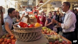 FILE - In 2010, then-president Barack Obama bought apples from a local vendor during his visit to the Reading Terminal Market in Philadelphia. (AP Photo/Pablo Martinez Monsivais)