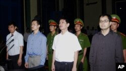 FILE - From left to right : Tran Huynh Duy Thuc, Nguyen Tien Trung, Le Thang Long and Le Cong Dinh listen to the verdict at a court in Ho Chi Minh City, Jan. 20, 2010.