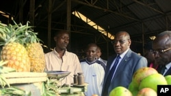 Rwandan central bank governor Claver Gatete visits markets in Kigali. He says regional integration is already a reality, but international efforts could drive down prices, November 1, 2011.