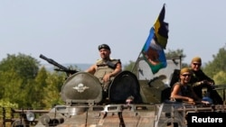 A Ukrainian military convoy moves along a road near Donetsk, Aug. 9, 2014.