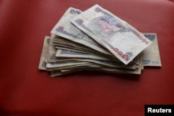 FILE - Nigerian naira notes are seen in this photo illustration.