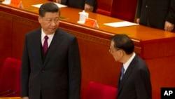 中国最高领导人习近平和中国总理李克强出席2019年4月30日举行的纪念五四运动100周年大会