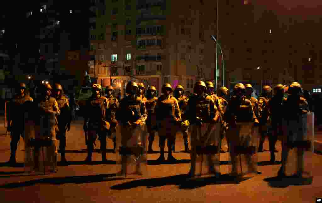 Military special forces stand guard at a street after Egypt's military chief says the president is replaced by chief justice of constitutional court in Nasser City, Cairo, July 3, 2013.