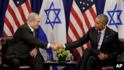 FILE - President Barack Obama shakes hands with Israeli Prime Minister Benjamin Netanyahu during a bilateral meeting at the Lotte New York Palace Hotel in New York, Sept. 21, 2016.