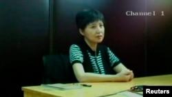 谷开来,2013年8月10日济南中级法院视频截屏。8月23日济南法院在薄熙来审判庭上展示该截屏