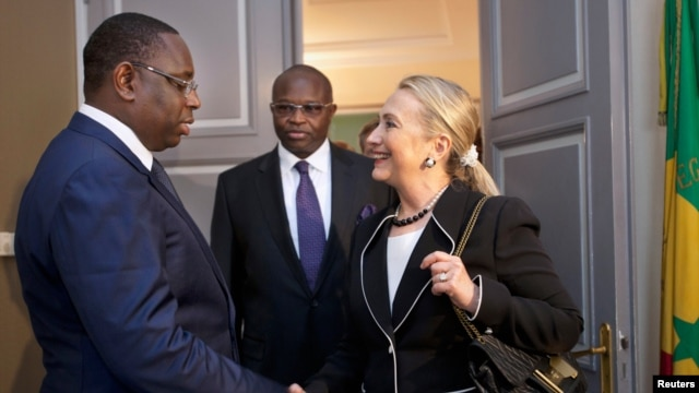 Hillary Clinton meets with Senegal's President Macky Sall at the Presidential Palace in Dakar August 1, 2012.