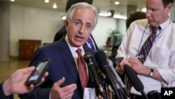 FILE - Senate Foreign Relations Committee Chairman Bob Corker, R-Tenn., shown talking to reporters after a briefing on talks with Iran in February, expects only a few votes on amendments to his Iran legislation.