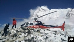 A helicopter prepares to rescue people at Everest Base Camp, which had been struck Saturday by an avalanche triggered by a massive earthquake in Nepal, on April, 27, 2015.