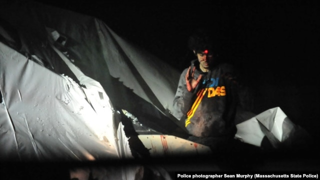 A sniper trains his bead on Tsarnaev.