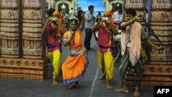 Indian folk artists from the eastern Indian state of Orissa perform during the three-day long Travel and Tourism Fair in Kolkata, July 13, 2012.