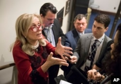 Rep. Debbie Dingell, D-Mich. (L) responds to reporters after members of the House Democratic Caucus met on Capitol Hill in the wake of reports of sexual misconduct by Rep. John Conyers, D-Mich., the longest-serving member of the House, in Washington, Nov.