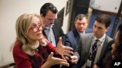 FILE - Rep. Debbie Dingell, D-Mich., talks to reporters in Washington, Nov. 29, 2017.