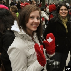 Stephanie Tarasoff, wears a pair of commemorative red mittens worn by the Canadian National team in the Opening Ceremonies February 12