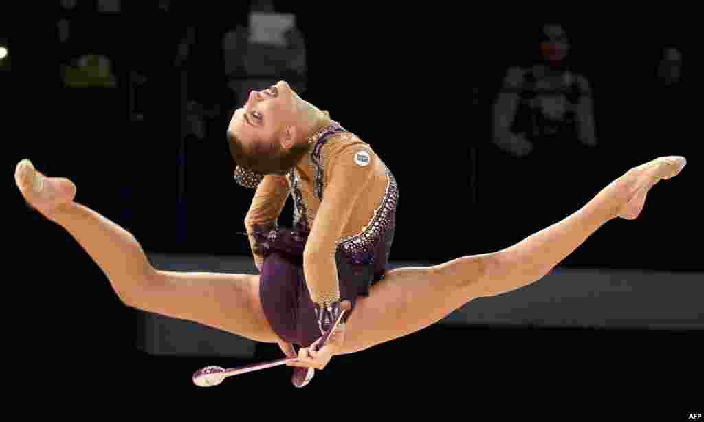 Third placed Melitina Staniouta of Belarus performs with the clubs during the final of the Rhythmic Gymnastics World Cup 2016 competition in Espoo, Finland.