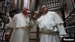 Father Karel Stautemas and Abbot Erik taste beer after blessing beer tanks at the Belgian Abbey of Grimbergen, which returns to brewing after a break of more than 200 years with a new microbrewery in Grimbergen, Belgium May 26, 2021. (REUTERS/Yves Herman)