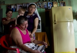 Maria Alvarenga, the mother of Jose Salvador Alvarenga, is comforted by relatives during an interview inside her home in the village of Garita Palmera, El Salvador, Feb. 4, 2014.