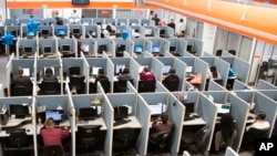 FILE - Workplaces have become high-stress spaces where many people feel overwhelmed.