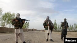 FILE - Members of the Taliban stand in Ghazni province.