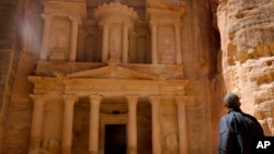 U.S. President Barack Obama stops to look at the Treasury during his tour of the ancient city of Petra, Jordan, March 23, 2013.