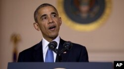 FILE - President Barack Obama speak at the White House in Washington, May 13, 2016. When Obama talks up the benefits of new trade deals, he holds out commerce with Vietnam as an example of the potential benefits of globalization.