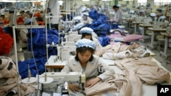 FILE - North Korean workers assemble jackets at a factory of a South Korean-owned company at the jointly run Kaesong Industrial Complex in Kaesong, North Korea, Dec. 19, 2013. (AP Photo/Kim Hong-Ji, Pool)