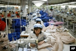 FILE - North Korean workers assemble jackets at a factory of a South Korean-owned company at the jointly run Kaesong Industrial Complex in Kaesong, North Korea.