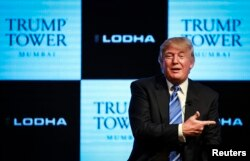 FILE - Donald Trump, pictured prior to his presidential run, speaks during a news conference to announce his first project in Mumbai, Aug. 12, 2014.