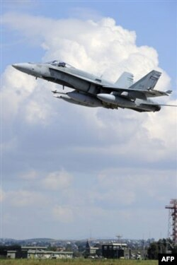 NATO Liviyada hukumat binosini bombardimon qilgan