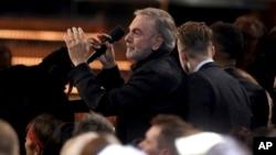 "Neil Diamond leads a carpool karaoke performance of ""Sweet Caroline"" at the 59th annual Grammy Awards, Feb. 12, 2017, in Los Angeles."