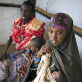 Newly arrived refugees wait to be registered at a refugee camp in Dadaab, near Kenya's border with Somalia, August 29, 2011.