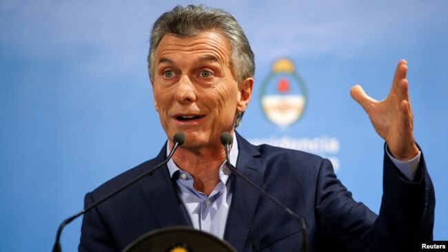 FILE - Argentina's President Mauricio Macri gestures during a news conference at the Olivos Presidential Residence in Buenos Aires, May 16, 2018.