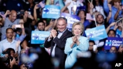 Democratic presidential candidate Hillary Clinton with Sen. Tim Kaine, D-Va., at a rally at Florida International University Panther Arena in Miami, July 23, 2016.