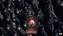Shayx al-Nimrning qatl etilishidan nozori eronlik namoyishchilar. Tehron, 4-yanvar 2016-yil.