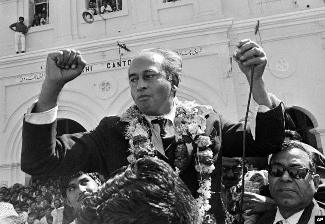 FILE - Then-chairman of the People's Party and former foreign minister Zulfikar Ali Bhutto is seen after arriving in Karachi in Feb, Pakistan, in Feb. 1969, following three months of imprisonment.